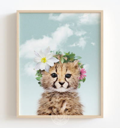 Baby cheetah with flower crown and blue sky