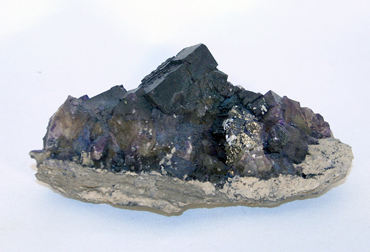 fluorite-cluster-purple-cubes-pyrite-calcite crystals on matrix