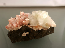 Apophyllite on pink Heulandite crystals backview