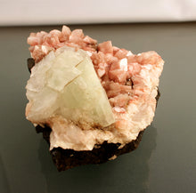 Apophyllite on pink Heulandite crystals closeup