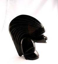 Carved Mayan figure in black onyx-side view