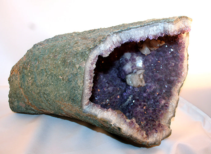 Amethyst crystal cave with calcite crystals