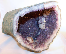 Interior of amethyst cave showing calcite crystals with pyrite dusting