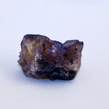 Fluorite complex crystal cluster - front - showing purple layer