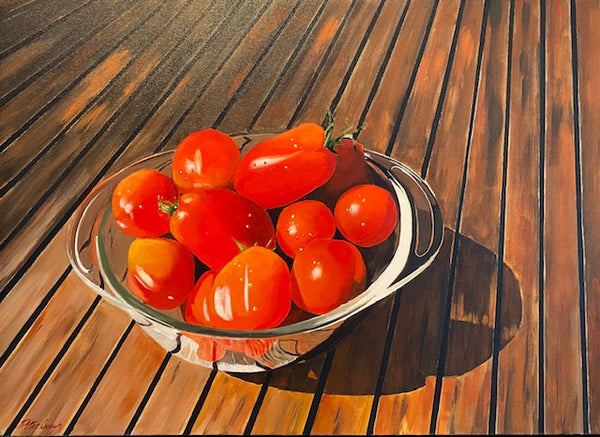 tomatoes in a glass bowl on a wooden table by artist Peter Gough