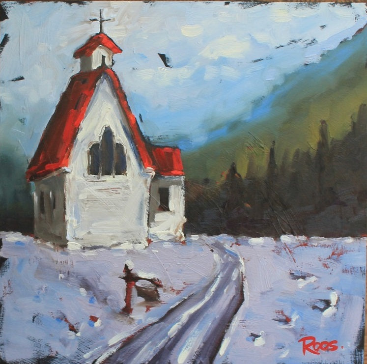 little white church with a red roof on a snowy lane by artist Lisa-Maj Roos