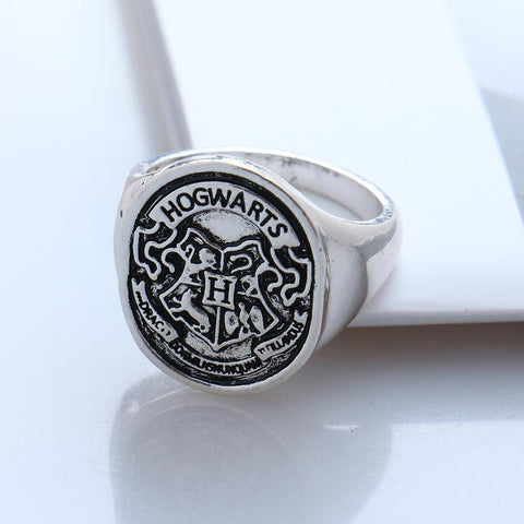 Surface Width: 20mm Setting Type: None Compatibility: All Compatible Metals Type: Zinc Alloy Material: Metal Gender: Women/Men Movie Jewelry: Harry Potter Ring Shape/Pattern: Hogwarts/Death Hallows Ring Size: 8,9,10 Metal Types: Zinc Alloy,Antique silver Plated