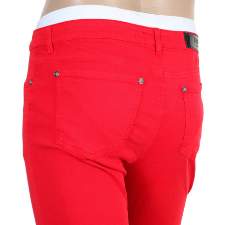 Red Jeans by Versace with lion head studs