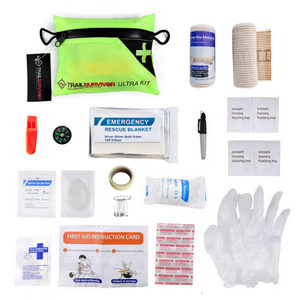 Expanded view of TrailSurvivor Ultra Kit. Contents Include: Snake Bite Kit, Emergency Space Blanket, Compass, Whistle, First Aid Essensials