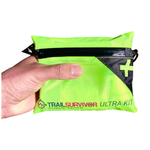 Load image into Gallery viewer, Hand Holding TrailSurvivor Ultra Kit a Lightweight Survival & First Aid Kit made Specifically for Running.