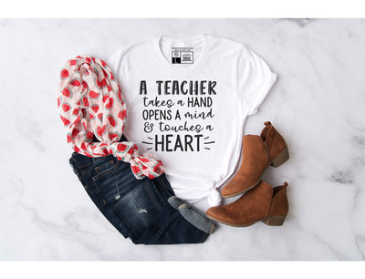 A Teacher Takes A  Hand And Touching a Heart T-Shirt - Beyond Measure Living