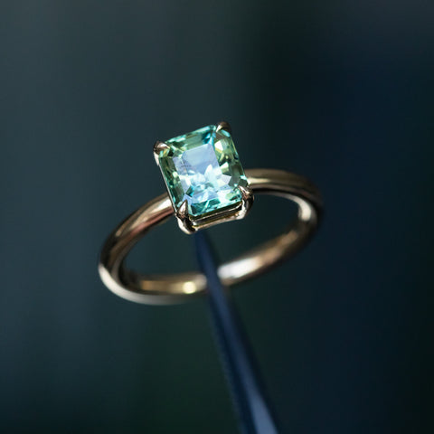 emerald cut sapphire yellow gold solitaire ring