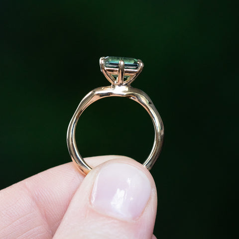 emerald cut six prong sapphire solitaire yellow gold ring
