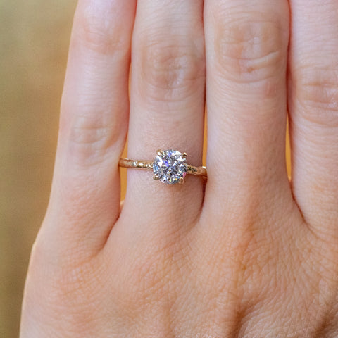 salt and pepper diamond evergreen solitaire ring in yellow gold