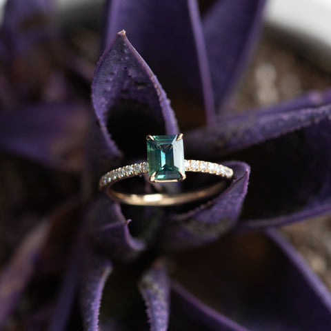 Emerald Cut Sapphire In 4-Prong Solitaire with French Set Diamonds in Yellow Gold