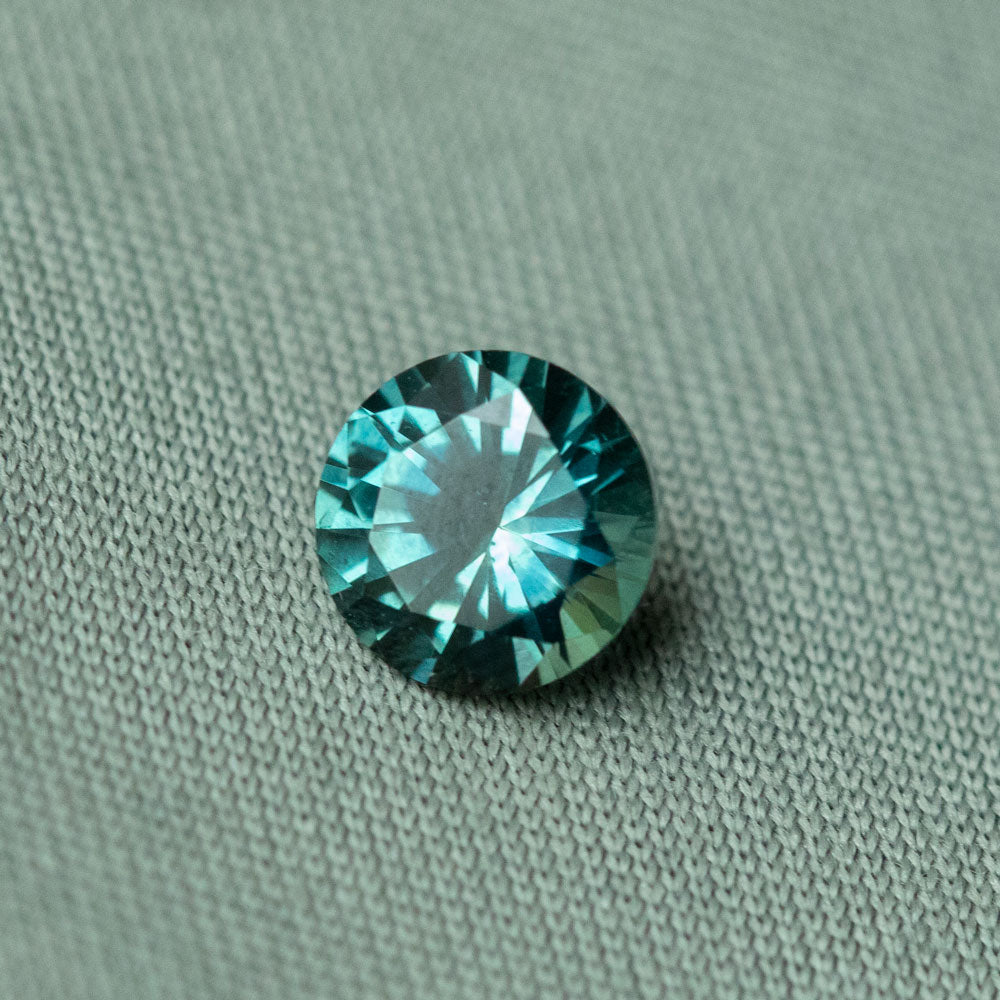 0.74CT ROUND MONTANA SAPPHIRE, TEAL BLUE, 5.52X3.42MM