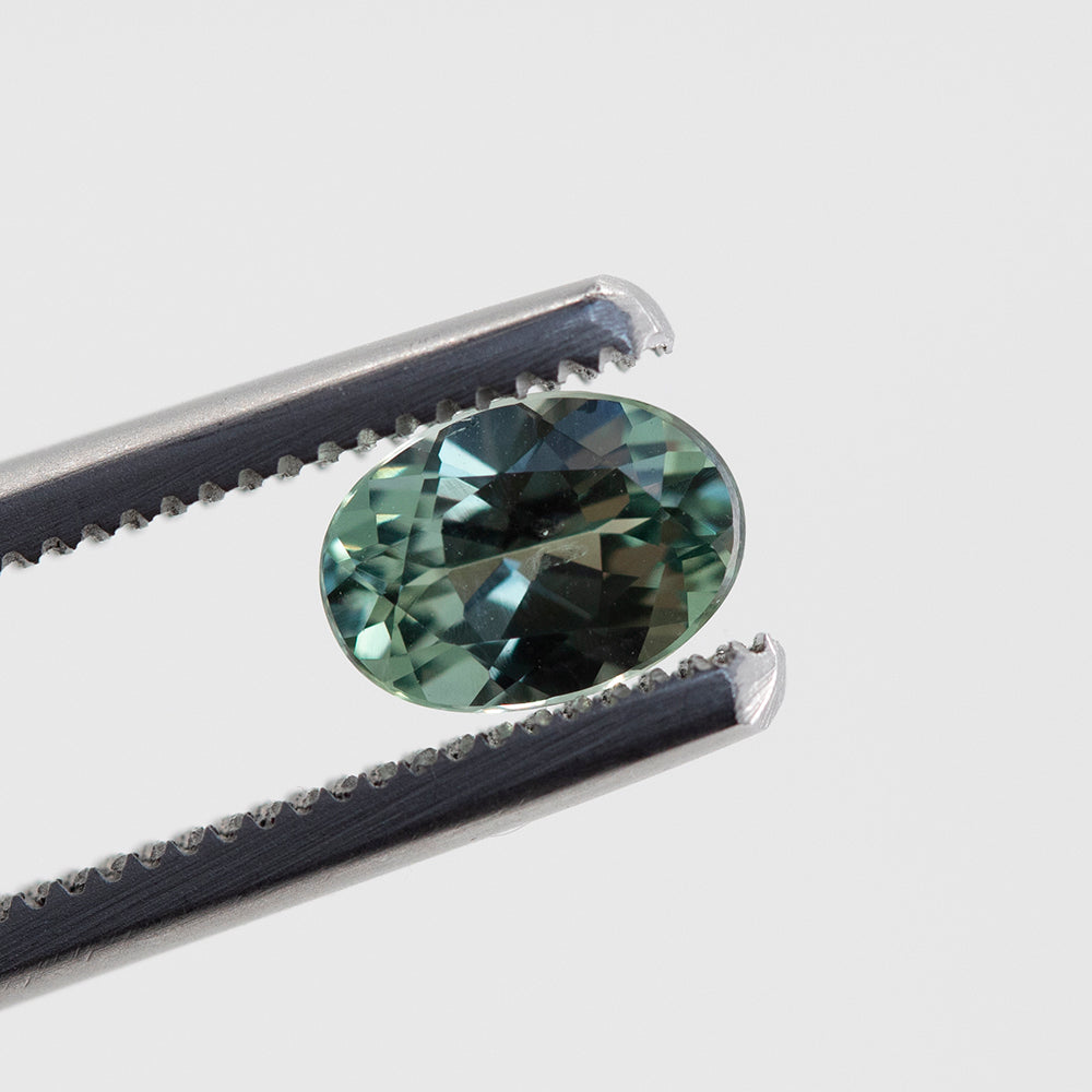 0.90CT OVAL MONTANA SAPPHIRE, STEELY SEAFOAM GREEN-GREY, 7X5MM