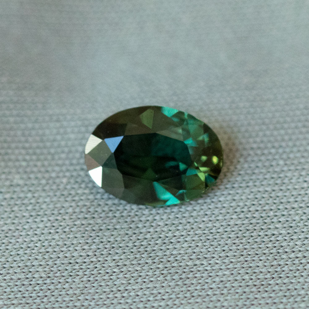 0.96CT OVAL KENYAN SAPPHIRE, DEEP FOREST GREEN, UNHEATED, 7.5X5.5MM, UNHEATED