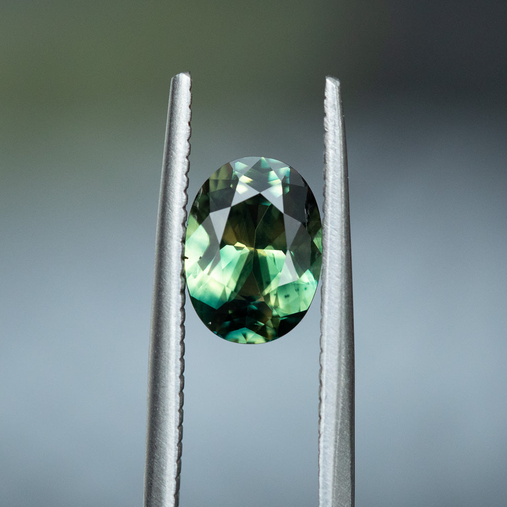 1.51CT OVAL MADAGASCAR SAPPHIRE, PARTI GREEN YELLOW, 8.42X6.2X3.51MM, UNTREATED