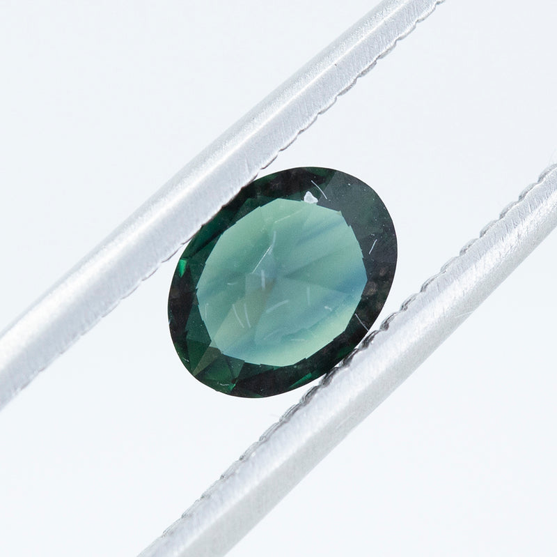 1.02CT OVAL NIGERIAN SAPPHIRE, DARK TEAL, UNHEATED, 7.17X5.47MM