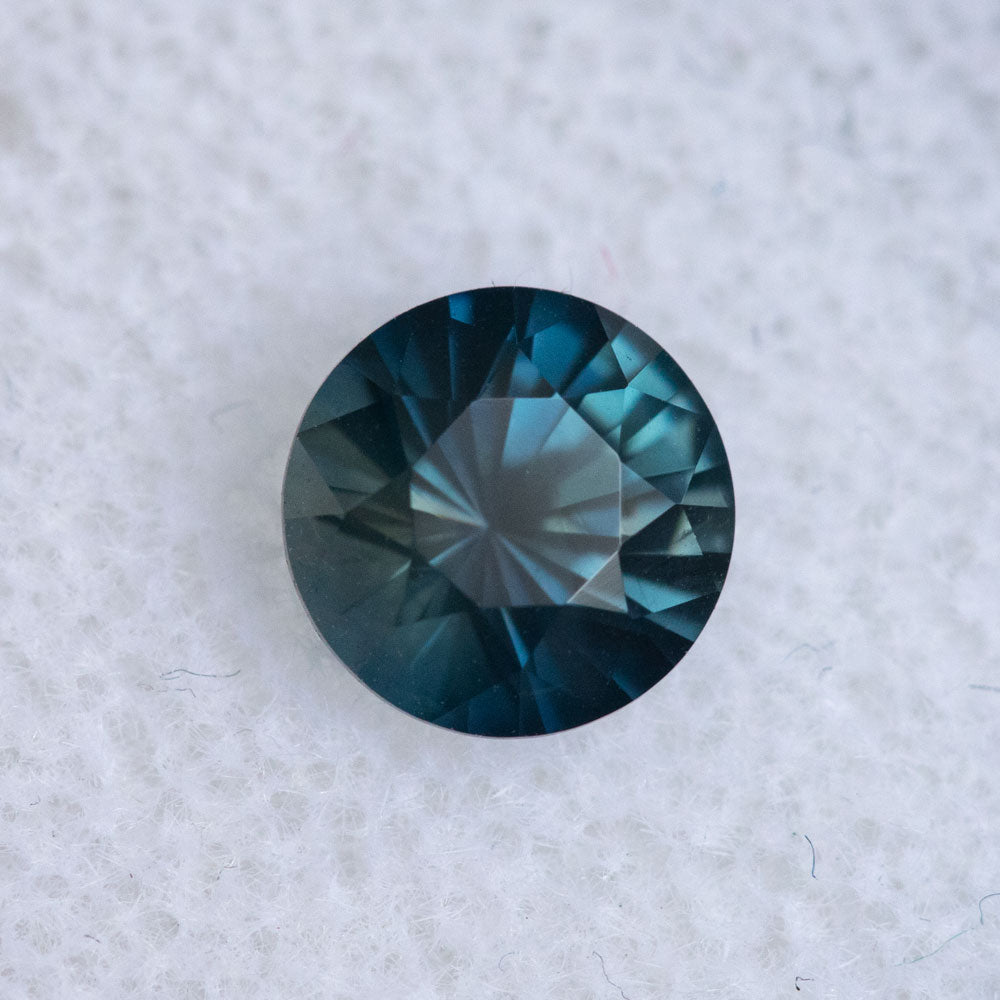 1.27CT ROUND MADAGASCAR SAPPHIRE, DEEP TEAL BLUE WITH PURPLE GREY, 6.49X4.41MM