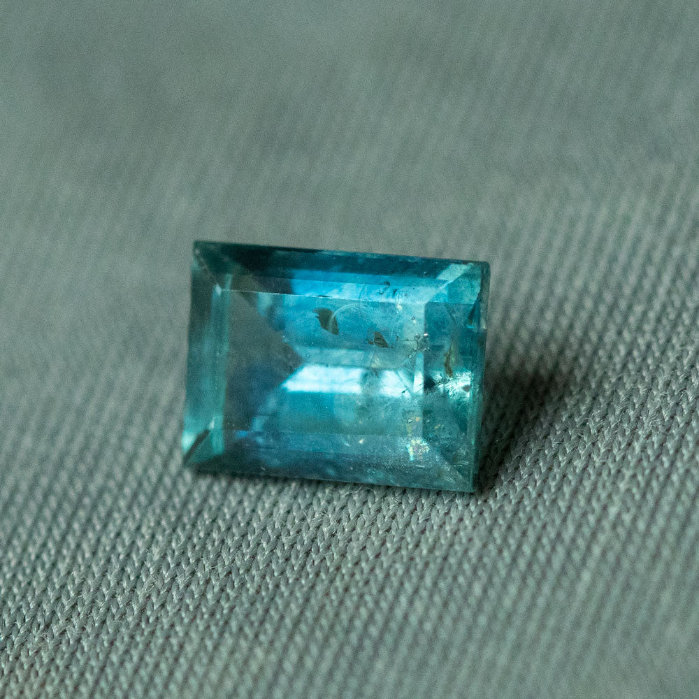 1.34CT EMERALD CUT MONTANA SAPPHIRE, BLUE, 7.02X5.03MM, UNTREATED