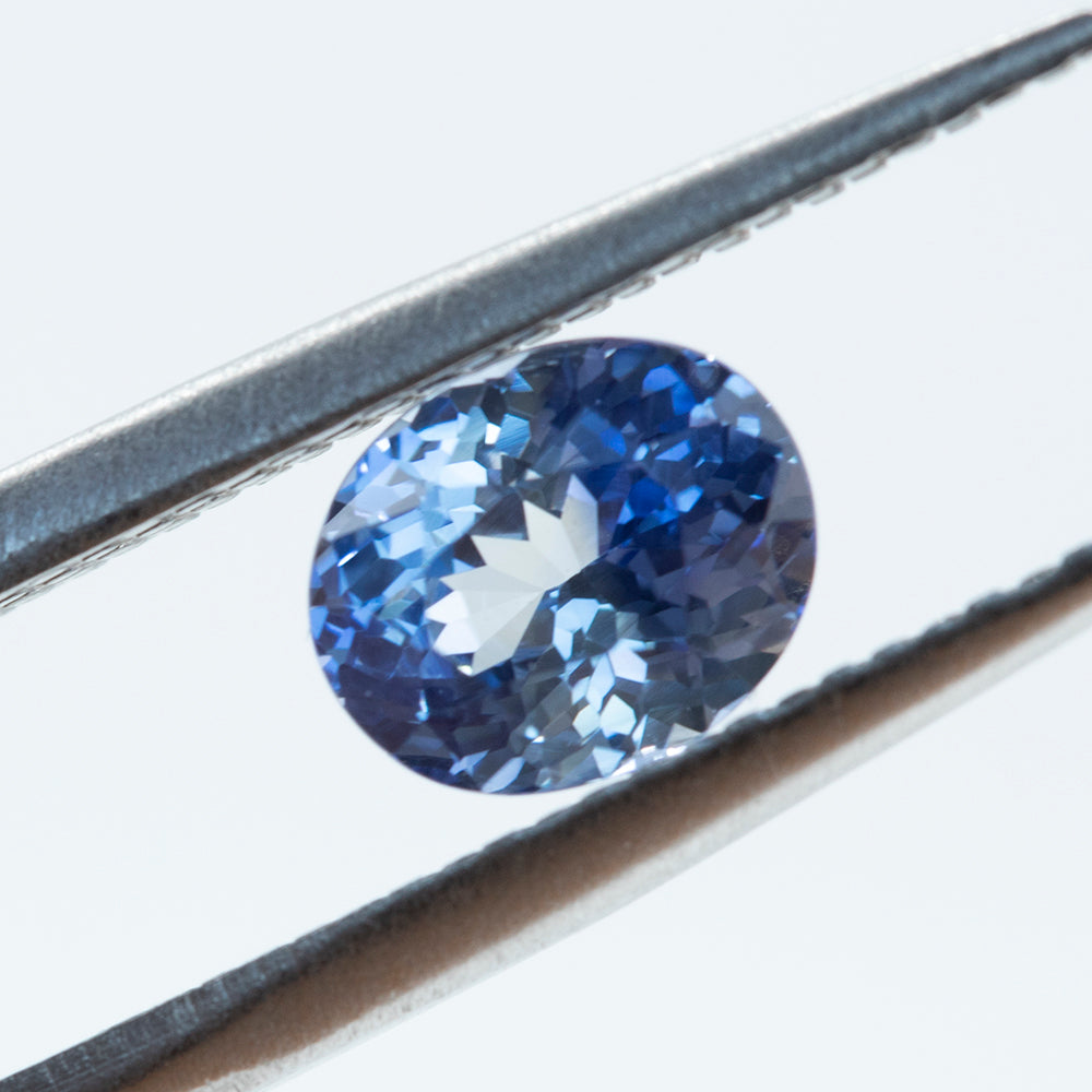 1.35CT OVAL SRI LANKAN SAPPHIRE, PARTI BI COLOR BLUE WHITE, UNTREATED, 7.04X5.8MM
