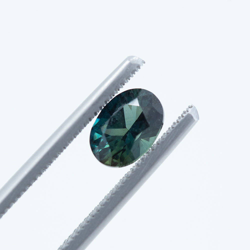 1.38CT OVAL NIGERIAN SAPPHIRE, ROYAL BLUE WITH TEAL, UNHEATED, 7.64X5.38MM