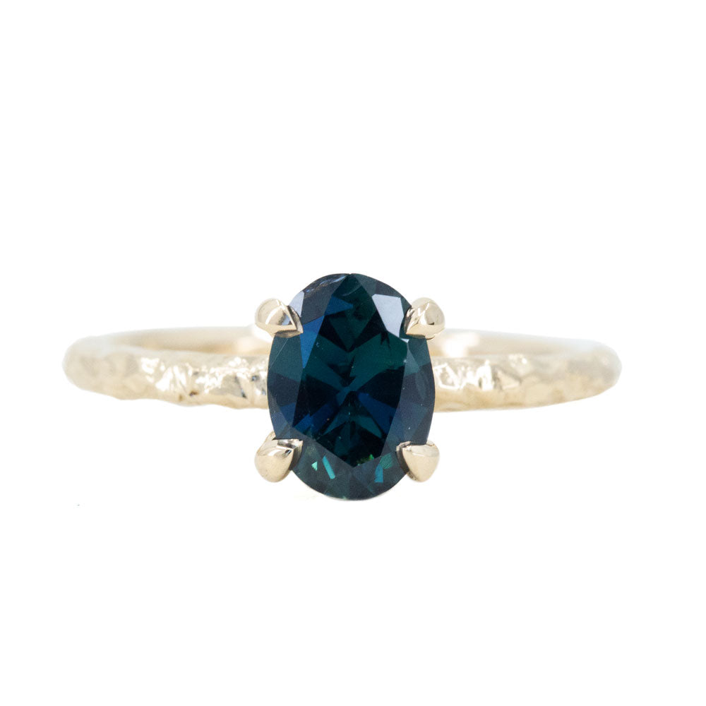 1.40ct Nigerian Blue Oval Sapphire Evergreen Solitaire Ring in 14k Yellow Gold