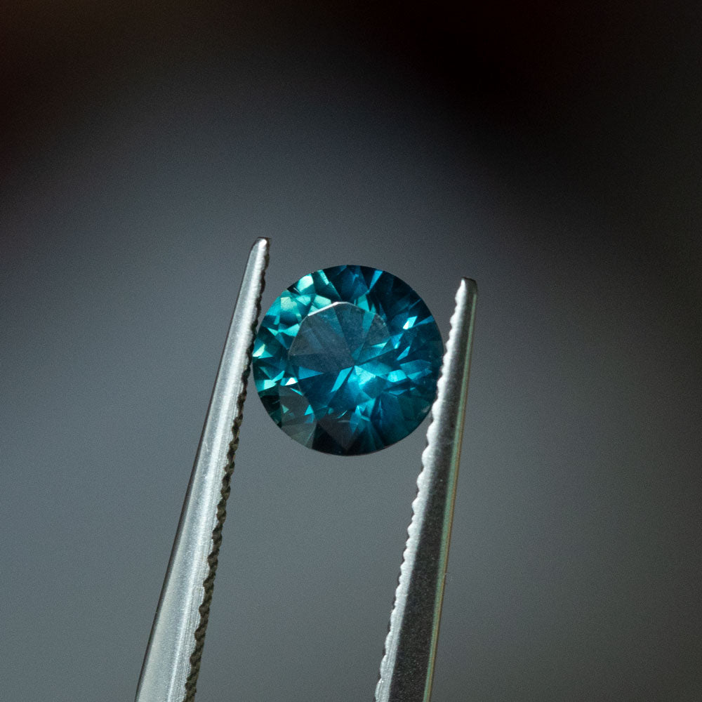 1.41CT ROUND NIGERIAN SAPPHIRE, TEAL BLUE, UNTREATED, 6.52X4.28MM
