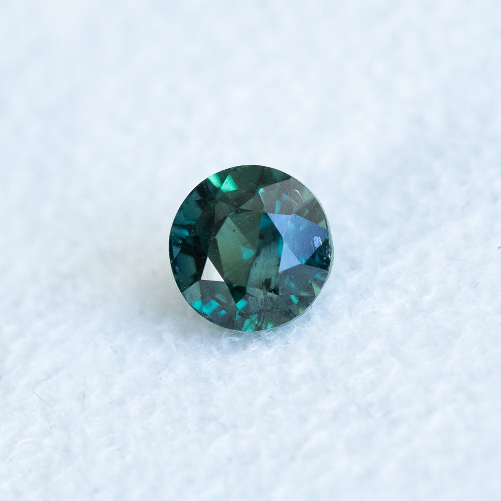 1.46CT ROUND MADAGASCAR, DEEP GREEN TEAL, 6.00X4.78MM