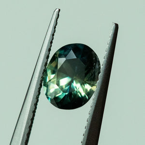 1.53CT OVAL NIGERIAN SAPPHIRE, PARTI GREEN BLUE, 7.69X6.05MM, UNHEATED