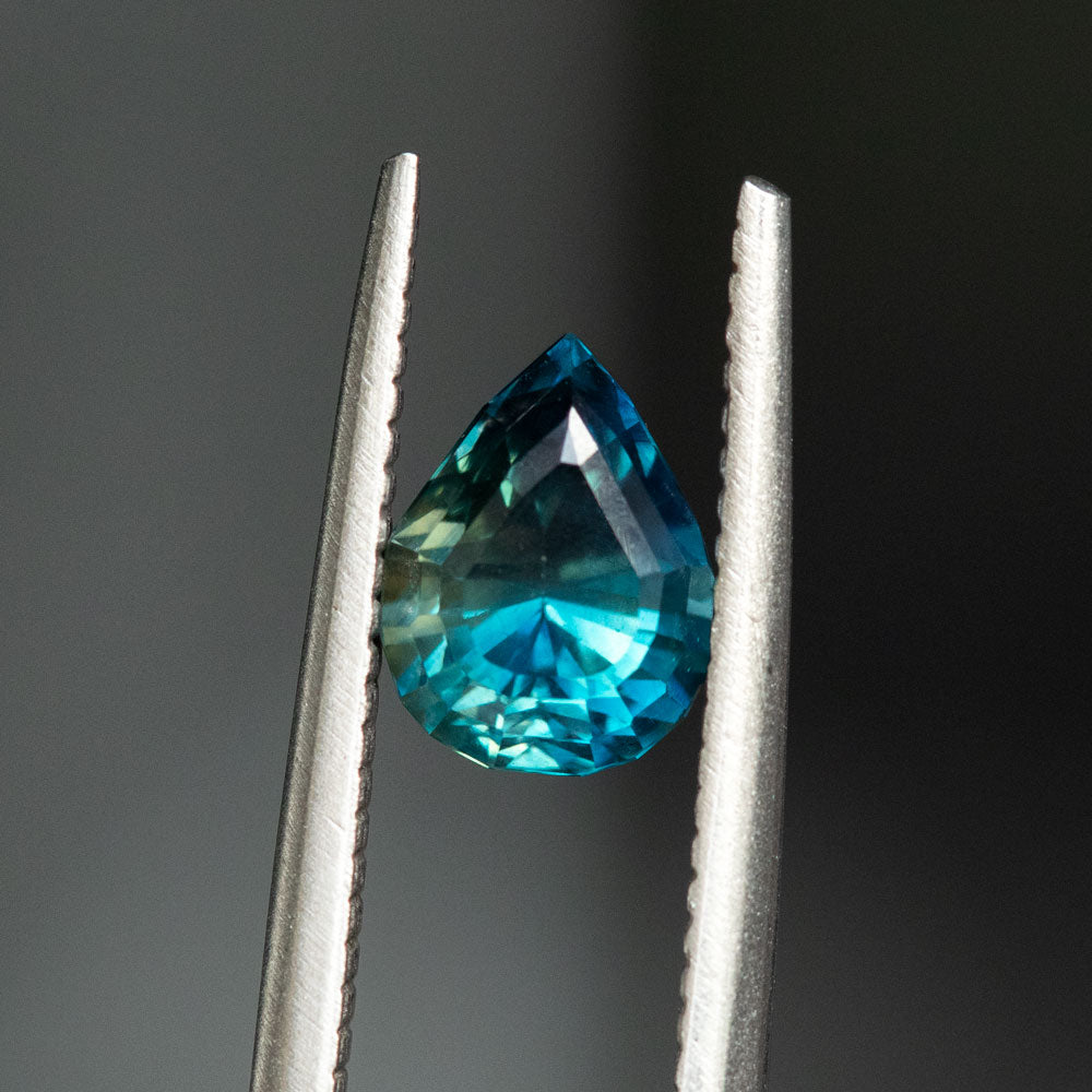 TEMPORARY HOLD 1.67CT PEAR NIGERIAN SAPPHIRE, PARTI TEAL BLUE,  7.64X5.83X5.07MM, UNTREATED,