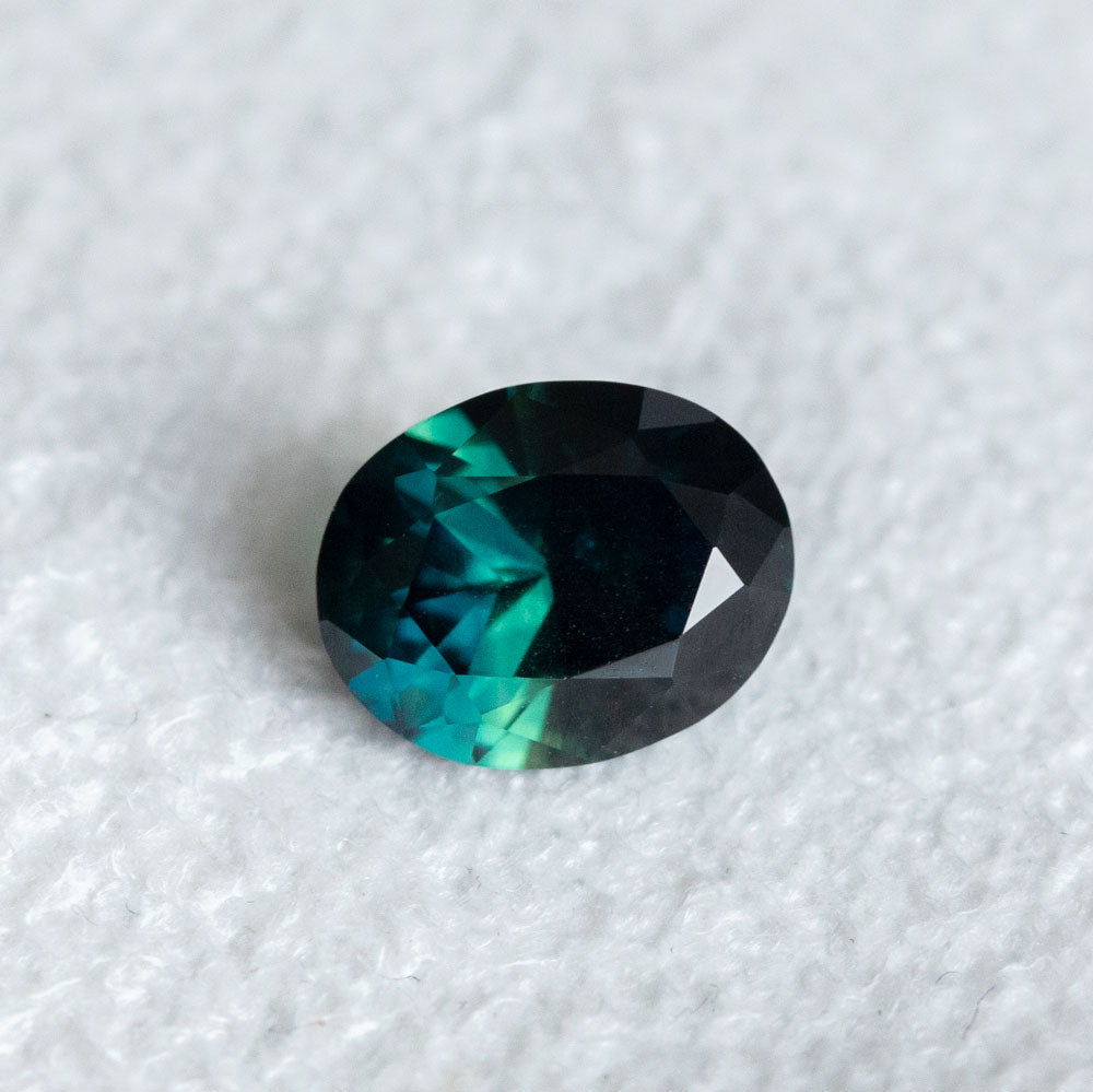 1.68CT OVAL NIGERIAN SAPPHIRE, DEEP TEAL BLUE GREEN, 7.91X6.36MM, UNTREATED