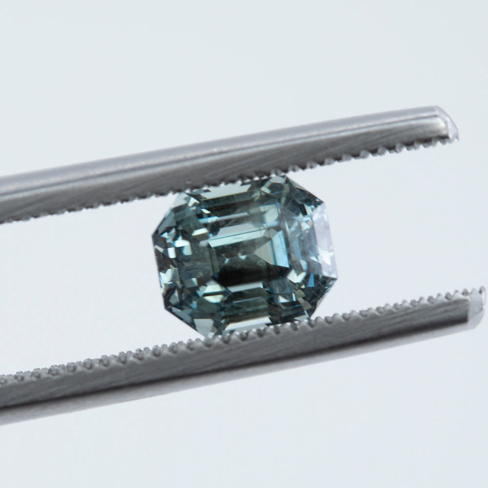 1.81CT EMERALD CUT MONTANA SAPPHIRE, COLOR CHANGING SEAFOAM GREEN TO STEELY GREY, UNTREATED, 5.4X6.5MM