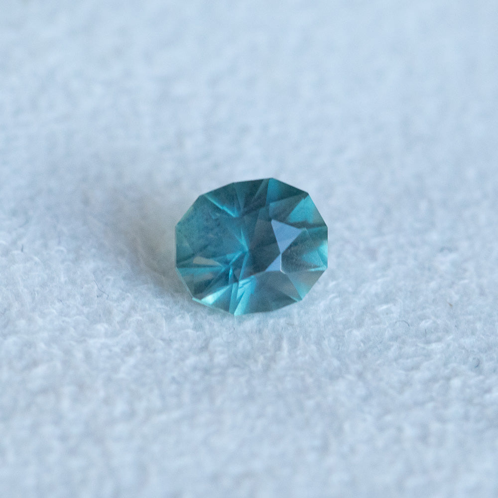 1.87CT GEO OVAL MONTANA SAPPHIRE, SILKY TEAL BUE, 7.23X6.25MM, UNTREATED