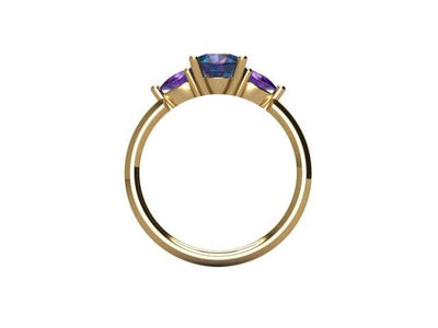 Custom Order- Three-stone ring setting for 1.1ct oval Montana Sapphire. With pink sapphire pear sides in 14k yellow. Reserved for C.