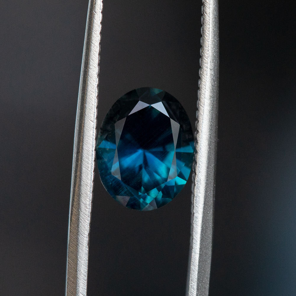 2.25CT OVAL NIGERIAN SAPPHIRE, DARK BLUE TEAL, 8.82X6.98MM, UNTREATED