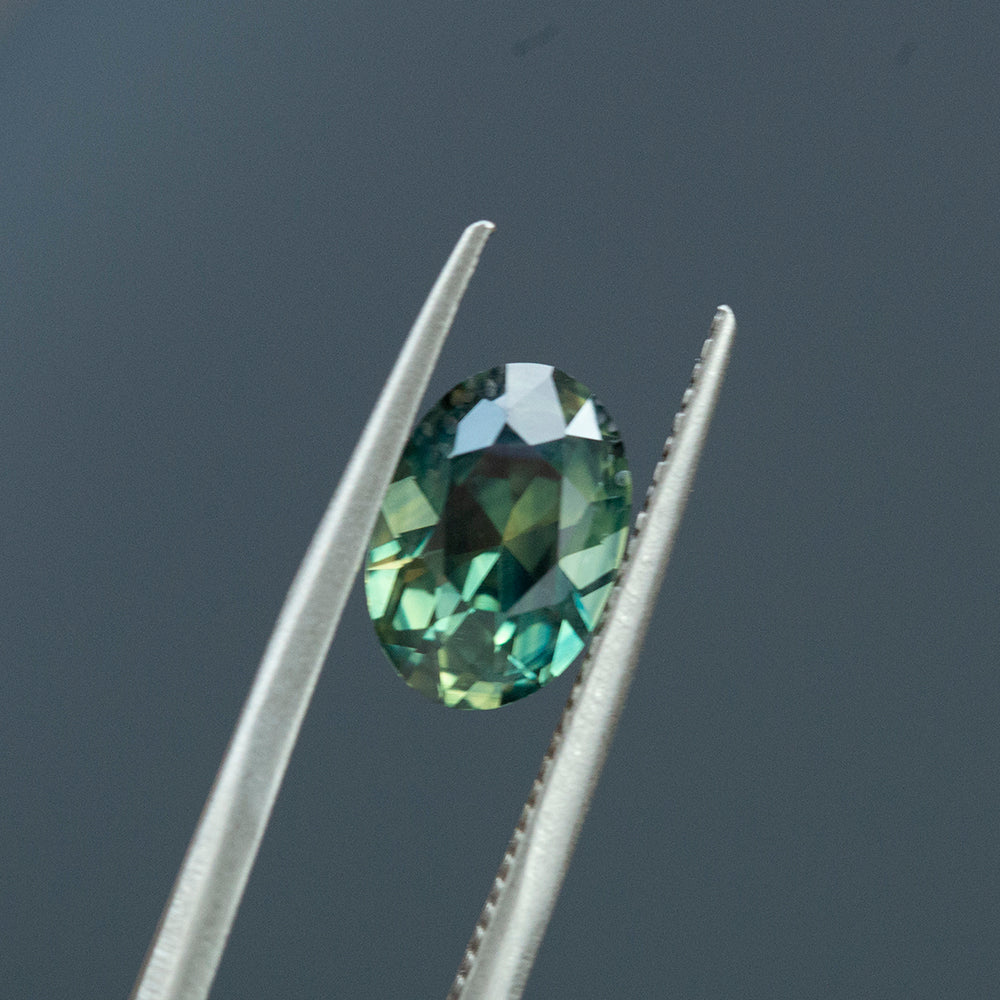 2.60CT OVAL NIGERIAN SAPPHIRE, DEEP TEAL GREEN, UNHEATED, 9.76X6.74MM