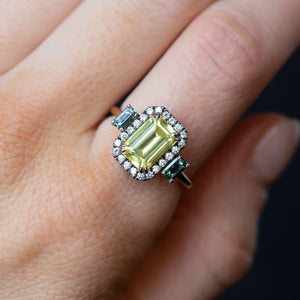 2.62ct Emerald Cut Nigerian Sapphire and Montana Sapphire Low Profile Scallop Cut Three Stone Ring with Antiqued Diamond Halo in 18k Yellow Gold