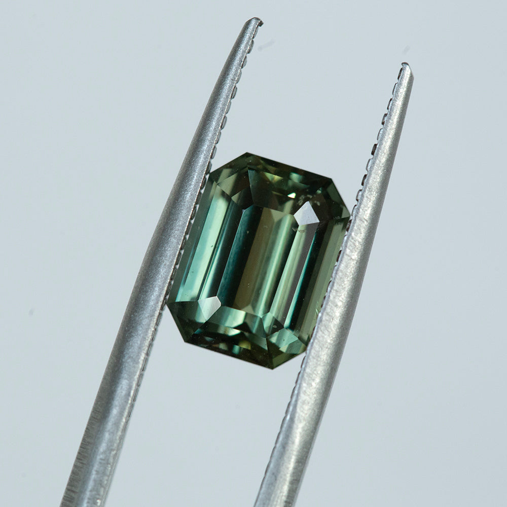 3.04CT EMERALD CUT MADAGASCAR SAPPHIRE, OLIVE GREEN, UNHEATED, 9.21X6.81MM