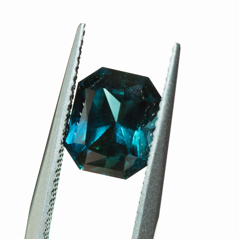 3.73CT RADIANT CUT NIGERIAN SAPPHIRE, DEEP BLUE WITH TEAL, 8.95X7.43MM, UNHEATED