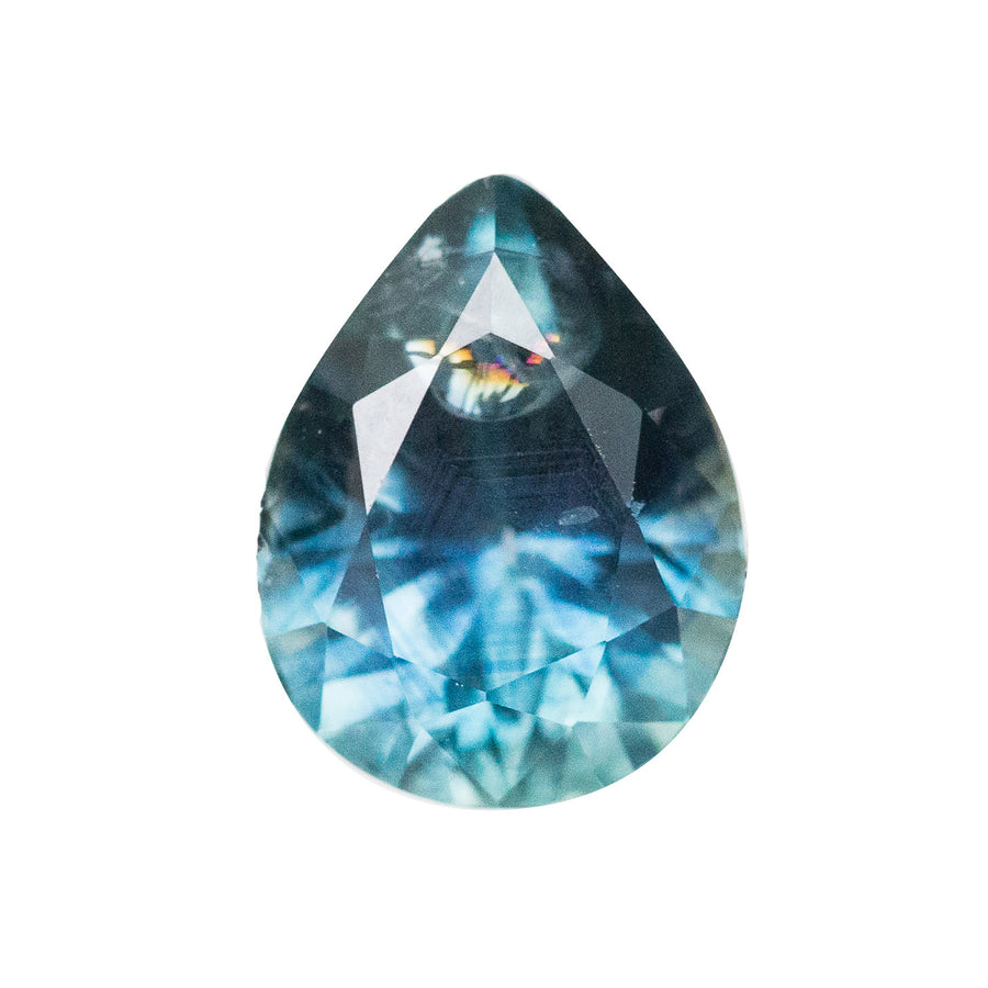 2.17CT PEAR MONTANA SAPPHIRE, BLUE AND SOME TEAL WITH RAINBOW INCLUSION IN THE TIP OF THE STONE, HEATED, 8.8X6.7MM