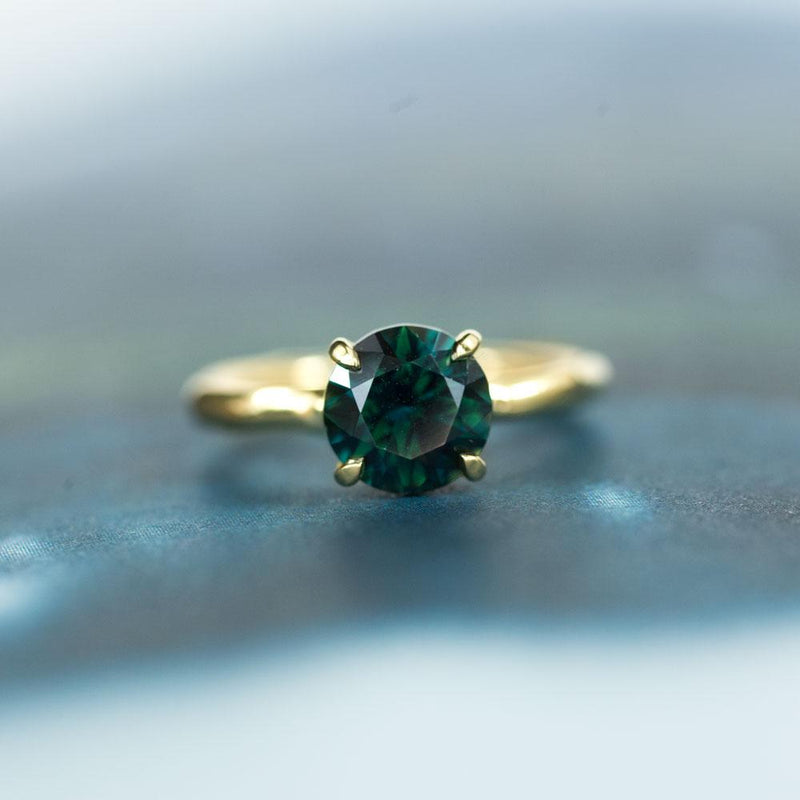 2.66 round deep teal blue green sapphire Alluvial solitaire ring in 18k yellow gold