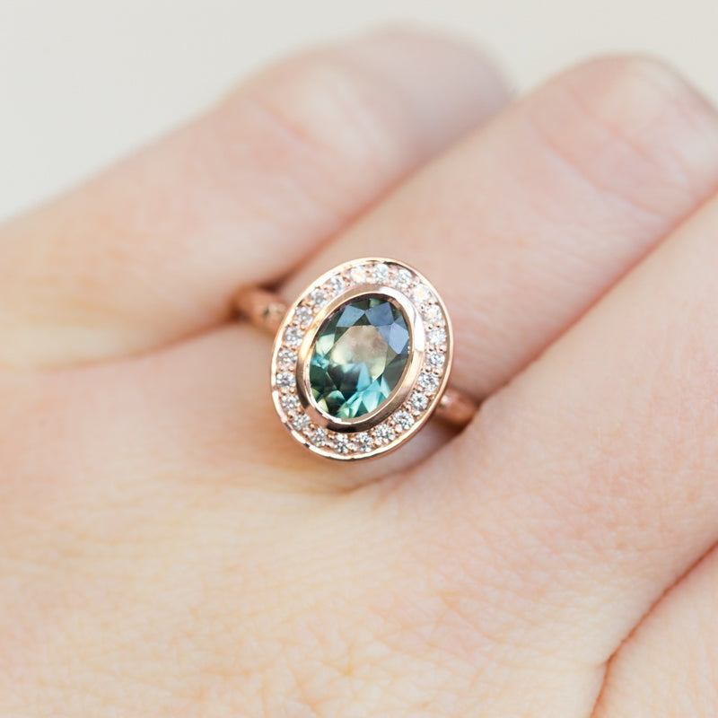 Oval Bezel Set 1.49ct Color Changing Teal Sapphire and Diamond Halo Engagement Ring - 14k Rose Gold Evergreen Band