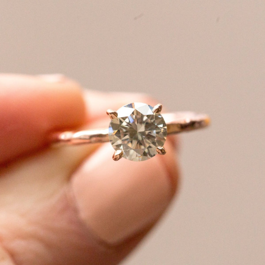 evergreen grey moissanite diamond earth friendly solitaire carved recycled gold engagement ring