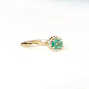 Neon Emerald East-West Oval Halo Ring in Evergreen Carved Yellow Gold