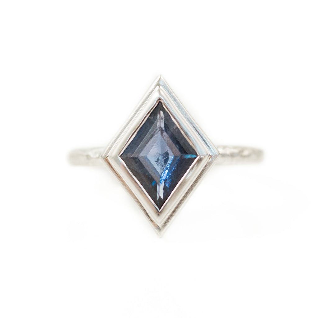 Kite Shaped Purple Blue Iolite in Evergreen Carved 18k White Bezel with satin finish