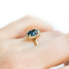 1.32ct Royal Blue Oval Sapphire Halo Ring - Evergreen Carved Band in a Satin Finish 14k Yellow Gold
