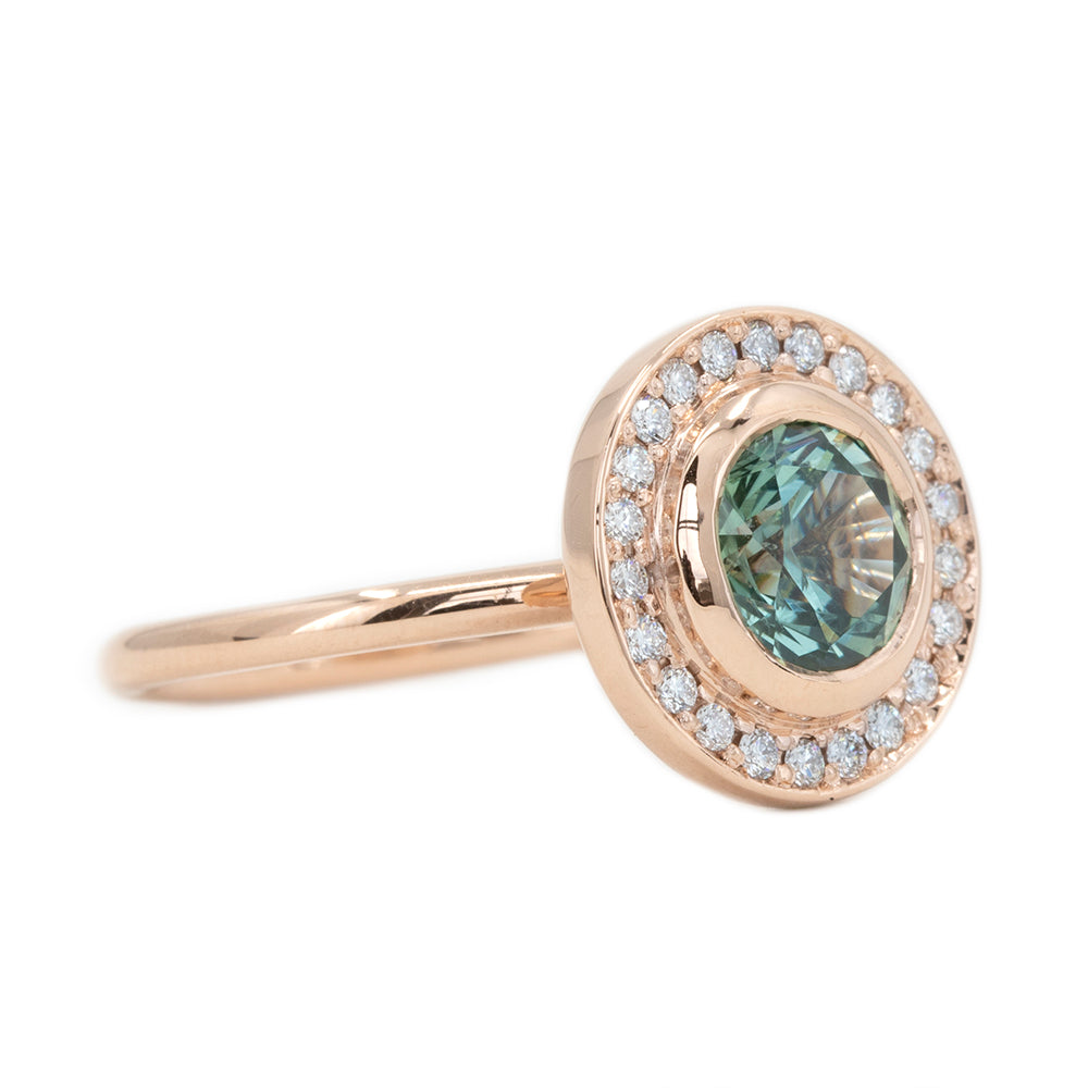 1.95ct Teal Montana Sapphire With Bezel Set Diamond Halo In 14k Rose Gold